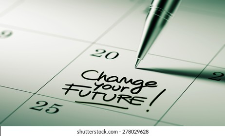 Closeup of a personal agenda setting an important date written with pen. The words Change your future written on a white notebook to remind you an important appointment.