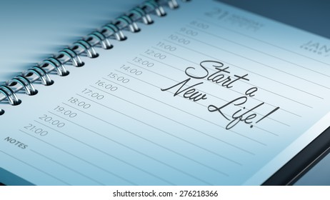 Closeup of a personal calendar setting an important date representing a time schedule. The words Start a new life written on a white notebook to remind you an important appointment.