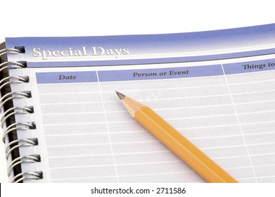 Close-up of a personal organizer and pencil.