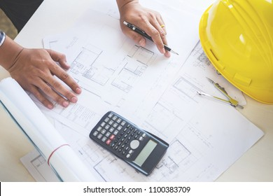 Blueprint plans images stock photos vectors shutterstock close up of persons engineer hand drawing plan on blue print with architect equipment malvernweather Choice Image