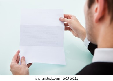 Close-up Of A Person's Hand Holding Blank Paper