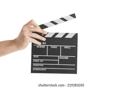 Close-up Of person's Hand Holding Clapperboard On White Background