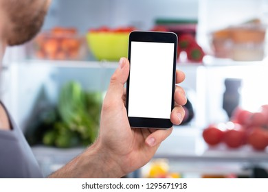 Close-up Of A Person's Hand Holding Mobilephone With Blank Screen