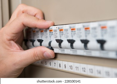 Closeup Of Person's Hand Repair The Switchboard