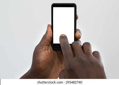 Close-up Of Person's Hand Using Cellphone With Blank Screen