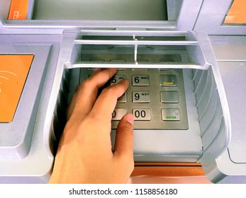 Close-up of a person's hands are pressed ATM PIN number.
