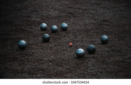 A close-up of Petanque boules near the piglet, in Cholet.