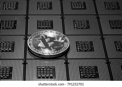 closeup of phisical bitcoin over computer cpu processors aligned. background and concept image. bn image