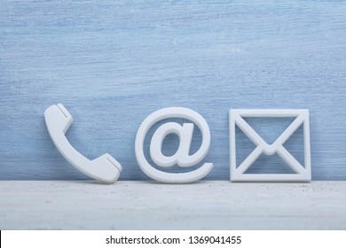 Close-up Of A Phone, Email and Post Icons. Contact us