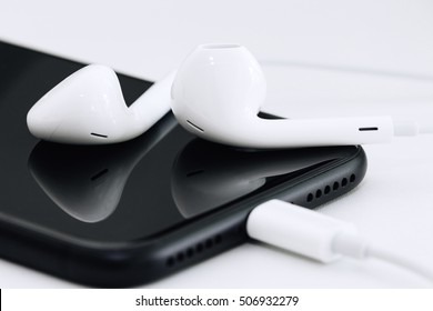 close-up phone and headphone on table