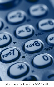 Close-up of Phone Keypad. Very shallow depth of field. Focus on letters RS7 and TUV. Visible texture of plastic.