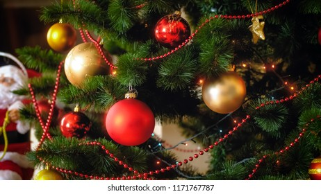 Closeup photo of adorned Christmas tree with golden and red baubles