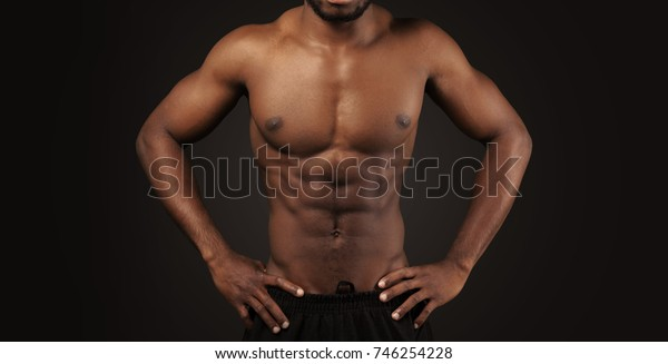 Close-up photo of afro american musculary young man