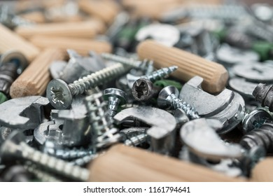 close-up photo of assorted screws for furniture assembly on the wooden table