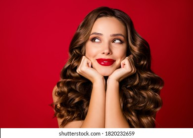 Closeup photo of attractive ideal beauty wavy lady sensual appearance bright lipstick arms near cheeks look empty space wear brassiere isolated vibrant red color background
