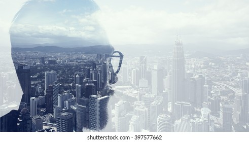 Closeup photo of bearded banker wearing glasses and looking city. Double exposure, panoramic view contemporary megalopolis background. Space for your business message. Wide
