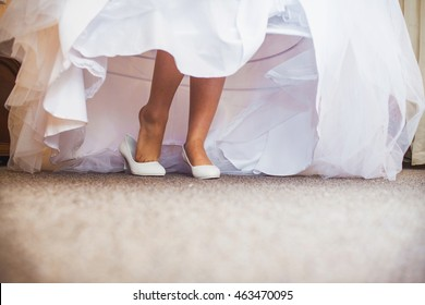 closeup photo of beautiful bride's shoes