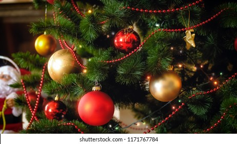 Closeup photo of beautiful colorful balls and glowing lights on Christmas tree