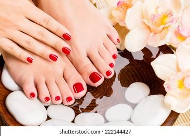Closeup photo of a beautiful female feet at spa salon on pedicure procedure