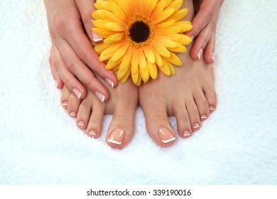 Closeup photo of a beautiful female feet with pedicure