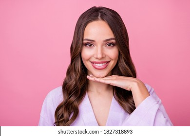 Closeup photo of beautiful lady long curly hairstyle spa salon procedures touch arm chin demonstrating perfect facial skin condition wear bathrobe isolated pastel pink color background