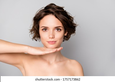 Closeup photo of beautiful naked lady bobbed short hairstyle look mirror reflection hold hand under chin good operation result isolated grey color background