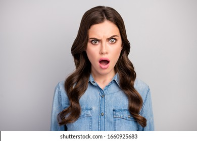 Closeup photo of beautiful pretty curly lady open mouth listen bad awful news displeased situation problems wear casual jeans clothes isolated grey color background