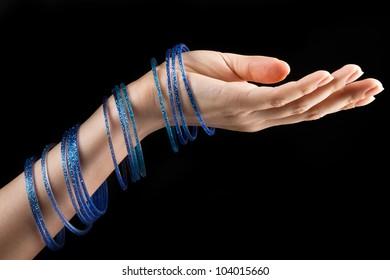 Closeup  photo of beautiful woman hand with bracelets