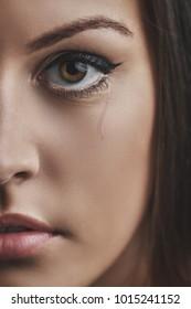 Closeup photo from a beautiful young sad woman crying