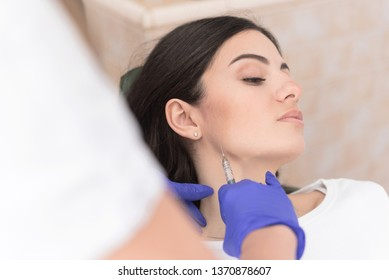 Closeup photo of beautiful young woman having aesthetic intervention in clinic, Aesthetic corrective treatments concept