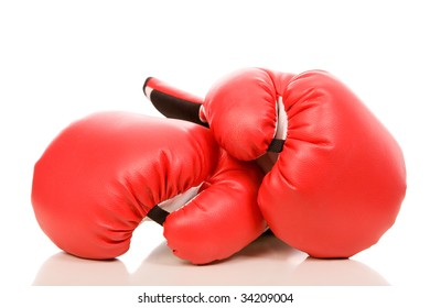 closeup photo of the boxing gloves with reflection on a white background