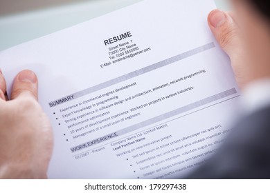 Close-up Of Photo Business Person Holding Resume