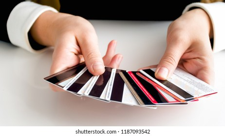 Closeup photo of businesswoman holding big stack of credit cards in hands