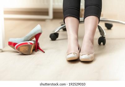 Closeup photo of businesswoman wearing ballet flats