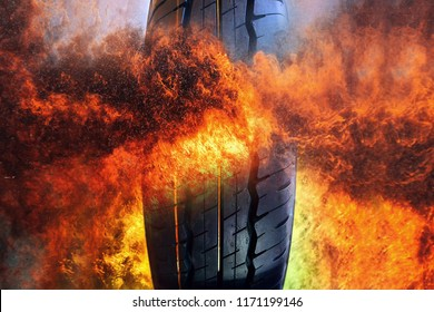 Close-up photo of Car tire on frame of fire  background . Rubber product .