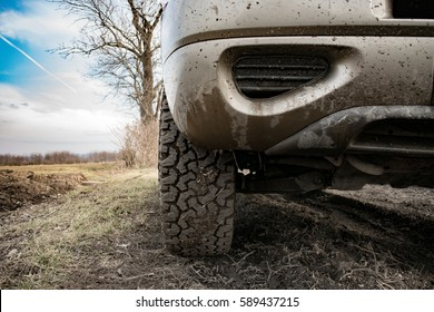 Closeup photo of car wheel on muddy terrain