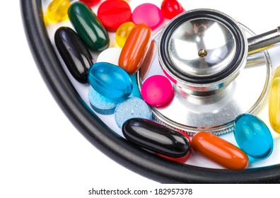 Closeup photo of colorful pills and stethoscope on  isolated white background