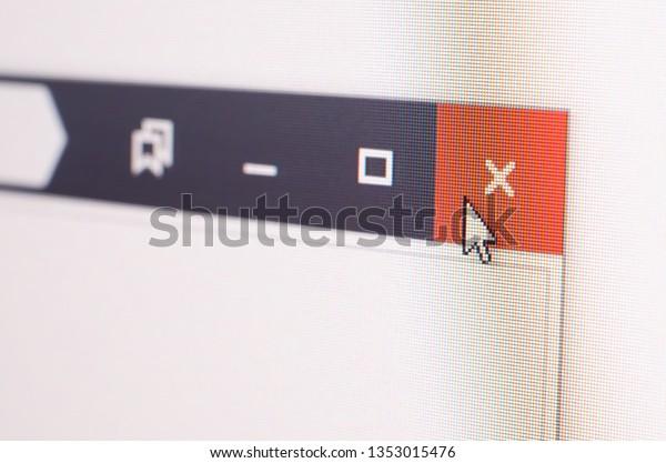 Closeup photo of cursor in internet browser click to closing cross.