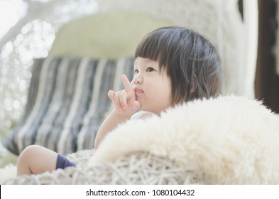Closeup photo of cute asian baby's expression