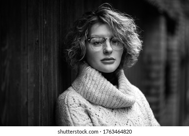 Closeup photo of a cute woman with glasses in nature