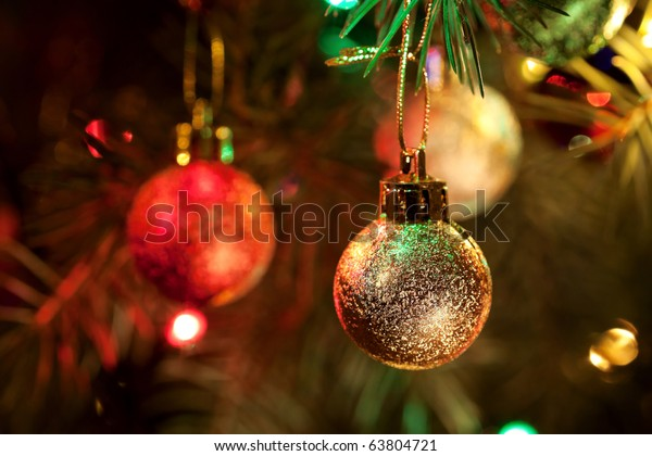 Close-up photo with decorations of christmas tree. Selective focus (Narrow depth of field).