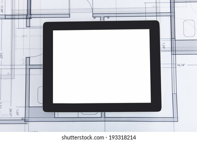 Closeup photo of digital tablet on blueprint
