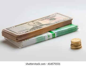 closeup photo of euro dollars and pennies on the white table