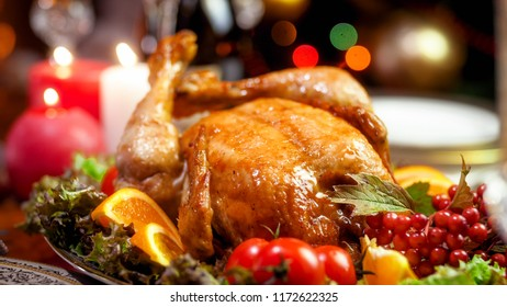 Closeup photo of family christmas dinner with baked chicken