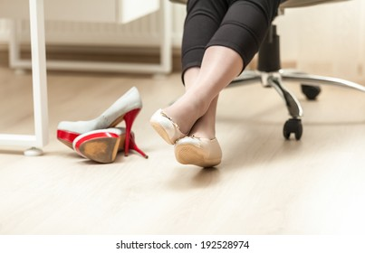 Closeup photo of female feet in ballet in office