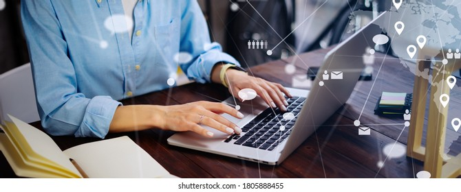 Close-up photo of female hands with laptop. Young woman working remotely at home. Concept of networking or remote work. Global business network. Online courses.