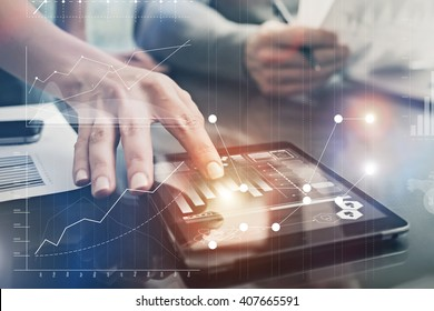 Closeup photo female hands touching screen modern tablet. Account managers working new investment project in office. Using electronic devices. Graphics icons, worldwide stock exchanges interface.