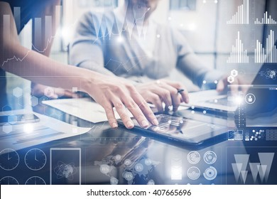 Closeup photo female hands touching screen modern tablet. Bankers team working new investment project in office.Using electronic devices. Graphics icons, stock exchanges interface. Horizontal