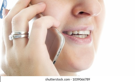 Closeup photo of female lips talking by mobile phone