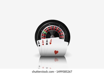 Close-up photo of four aces standing ahead of a black roulette, isolated on white background. Playing cards. Gambling entertainment.